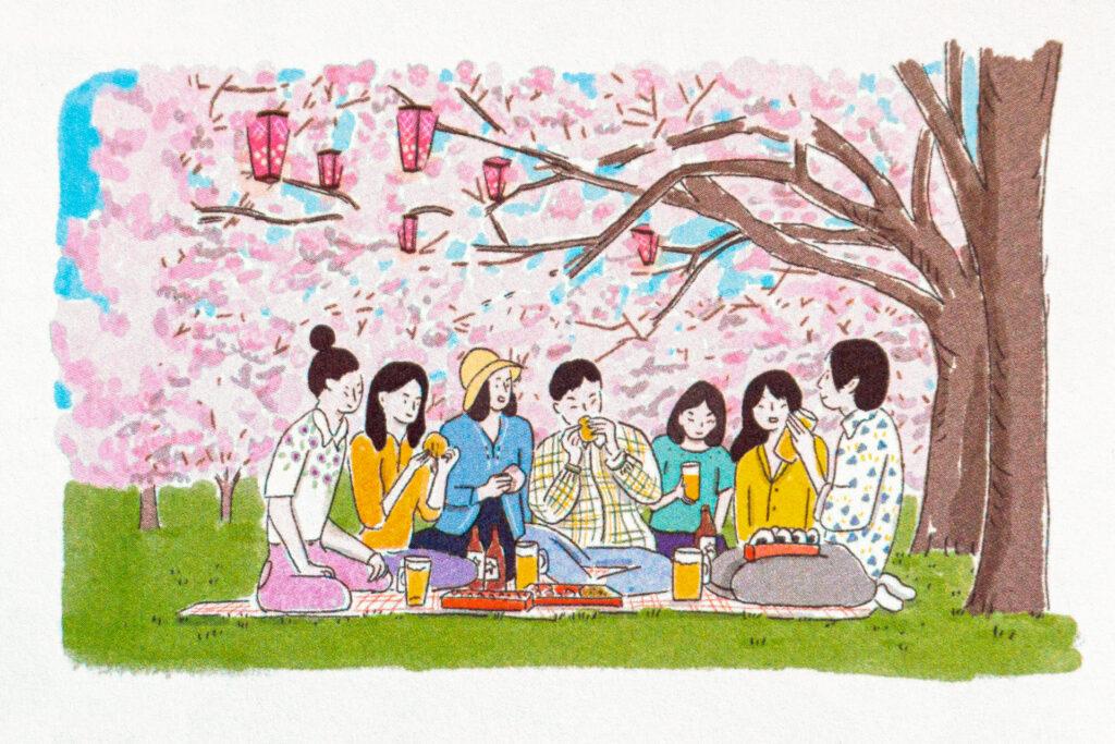 Hanami entre amis sous les fleurs de cerisier